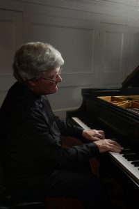 Marc Ryser playing piano