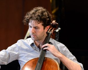 James Churchhill playing the cello
